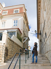A tourist in the streets of Cascais, Portugal