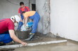 workers in construction room poured concrete floor