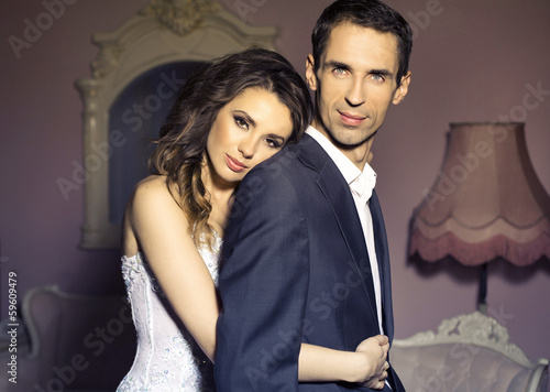 Serious wedding couple in romantic pose