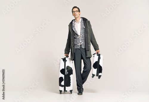 Businessman with two colorful suitcases