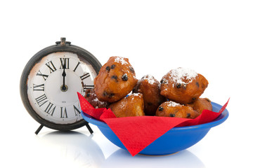 Dutch traditional oliebollen and clock