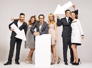 Group of attractive people pointing vectors