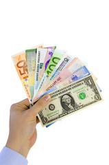 Hand hält Fächer mit Banknoten verschiedener Länder
