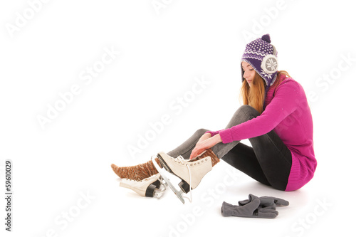 Attractive woman put on the ice skates