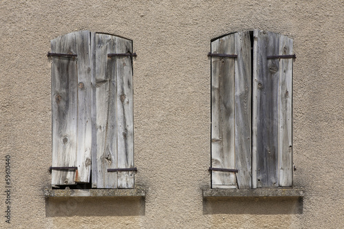 Closed wooden shutters on window