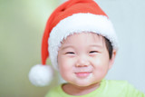 baby boy wearing christmas cap