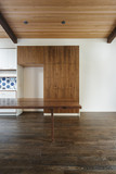 Wooden dining table in empty modern house