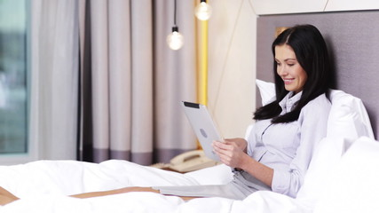 businesswoman working with tablet pc computer in hotel