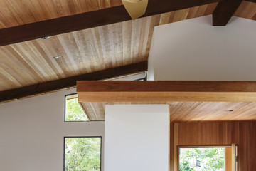 Detail of wood beam ceiling in a modern house entryway