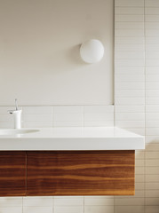 Detail of bathroom counter and tile in modern home