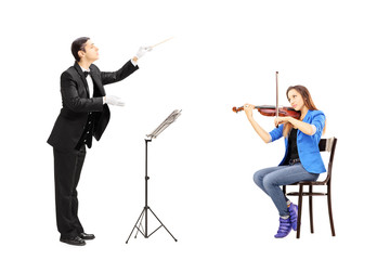 Male orchestra conductor directing a female playing violin