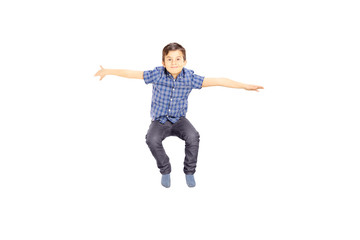 Smiling little boy jumping