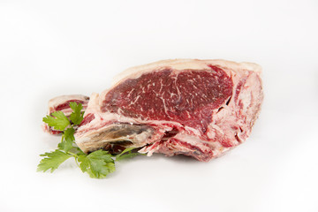 A fresh rib eye steak isolated on white background