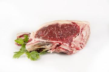 A fresh rib eye steak isolated on white background