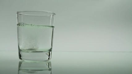 Tablet Dissolving in Glass Aspirin Headache Concept