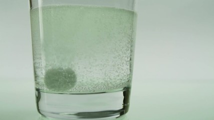 Aspirin Dissolving in Water
