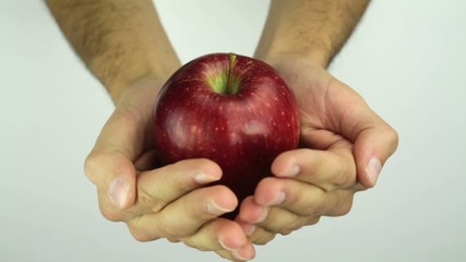 Red Apple in Man's Hands