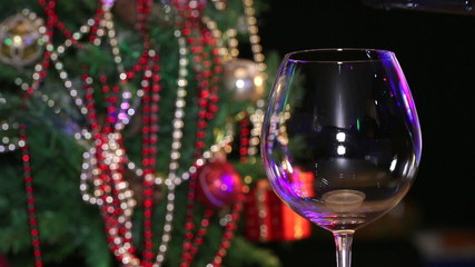 Pouring red wine and christmas tree