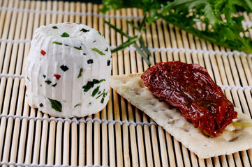 Tomino cheese and dried tomato