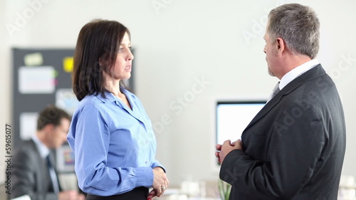 Two business people chatting