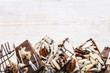 Chocolate bark on wood background