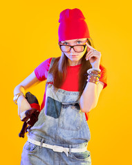 Portrait of funny girl in glasses and red caps
