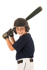 young boy baseball player batting right handed smiling