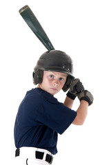 Young baseball player batting left handed focused