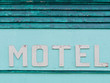Painted blue-green historic motel facade siding