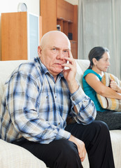 Upset senior man against sad wife