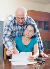Mature woman fills documents