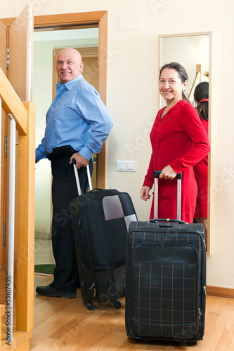 Senior tourists with luggage