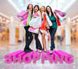 Happy women with shopping bags at store