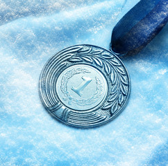 Medal on snow