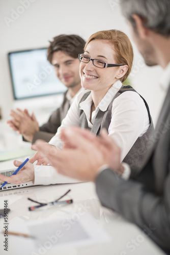 applause for a female colleague in a meeting