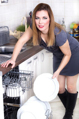 sexy woman in kitchen doing housework