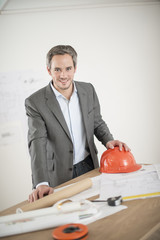architect with hardhat on a construction site