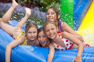 happy girls in the inflatable pool