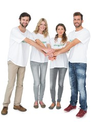 Group portrait of happy volunteers with hands together