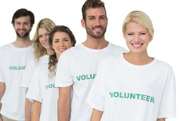 Group portrait of happy volunteers standing in a row