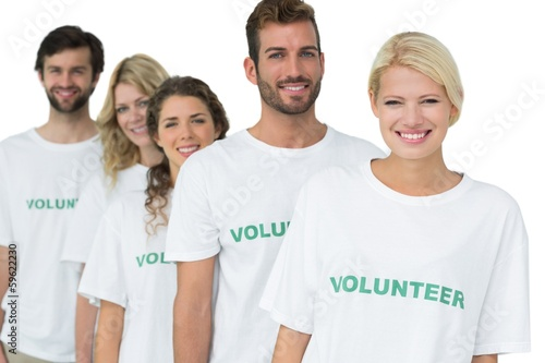 Group portrait of happy volunteers standing in a row