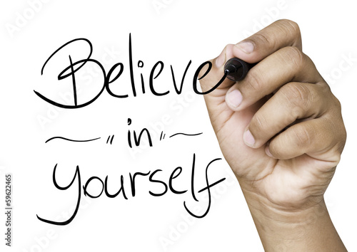Believe in Yourself hand writing on a transparent board
