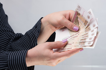 Female hands hold banknotes