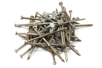 bunch of rusty nails on white background