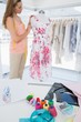 Female fashion designer working on floral dress at studio