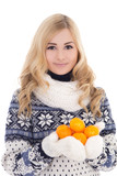 beautiful girl in winter clothes with mandarins isolated on whit