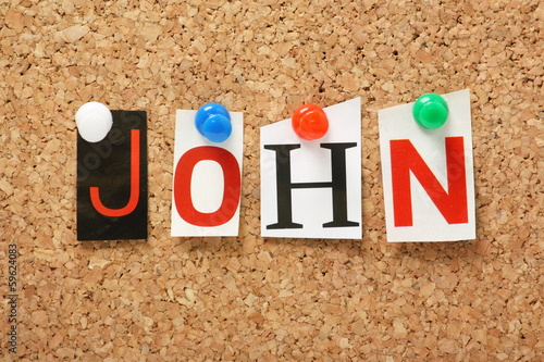 The name John on a cork notice board