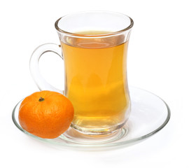 Cup of orange tea with orange