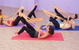Fototapety Aerobics HOT pilates group with rubber bands in a row