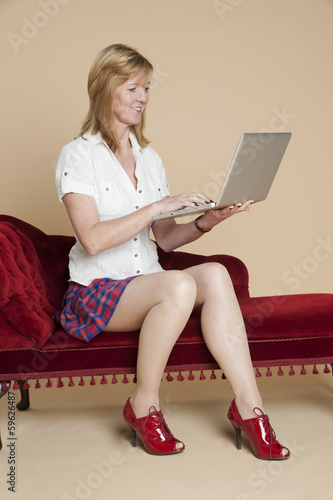 Woman in white shirt  using a laptop computer
